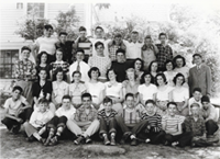 Class Photo taken outside the old High School (now the Flynn Building)